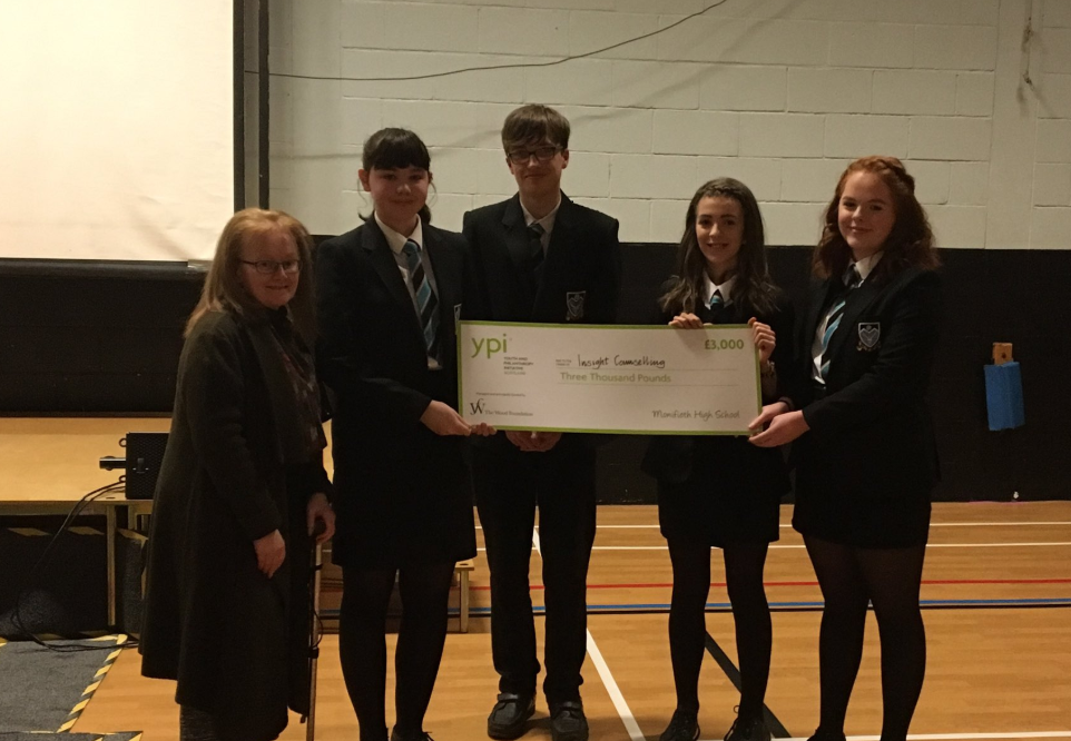 Monifieth High youngsters Sarah Geekie, Jay Revill, Holly Birtwistle and Daisy Todd with a representative of Insight