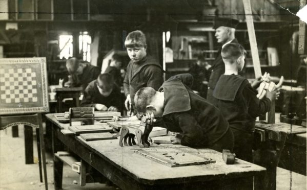 A joinery workshop on board Mars Training Ship in 1928.