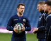 Scotland captain Greig Laidlaw discusses tactics with Finn Russell and Ali Price.
