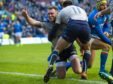 Scotland's Stuart Hogg scores Scotland's third try against Italy.