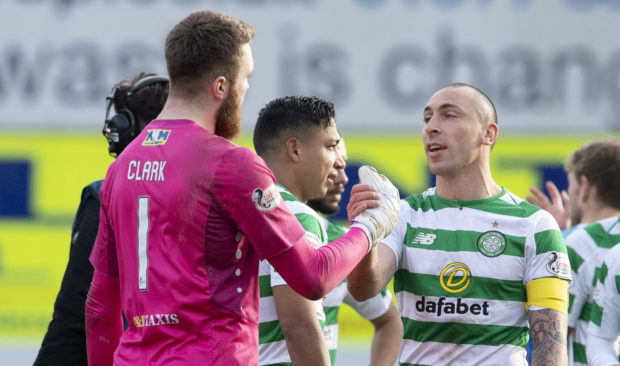 Respect: Zander Clark shakes hands with Celtic captain Scott Brown at full-time on Sunday.