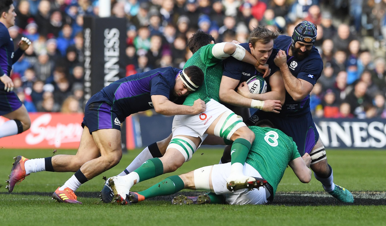 Scotland's Jonny Gray is tackled by Ireland's Jack Conan.