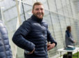 Finn Russell was all smiles at training on Monday, but yesterday was ruled out of the game in Paris.