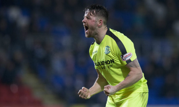 Marc McNulty celebrates after making it 2-1 to Hibs.