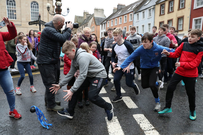 Boys chase the leather ball during the annual 'FasternÕs E'en Hand Ba' event on Jedburgh's High Street in the Scottish Borders.
