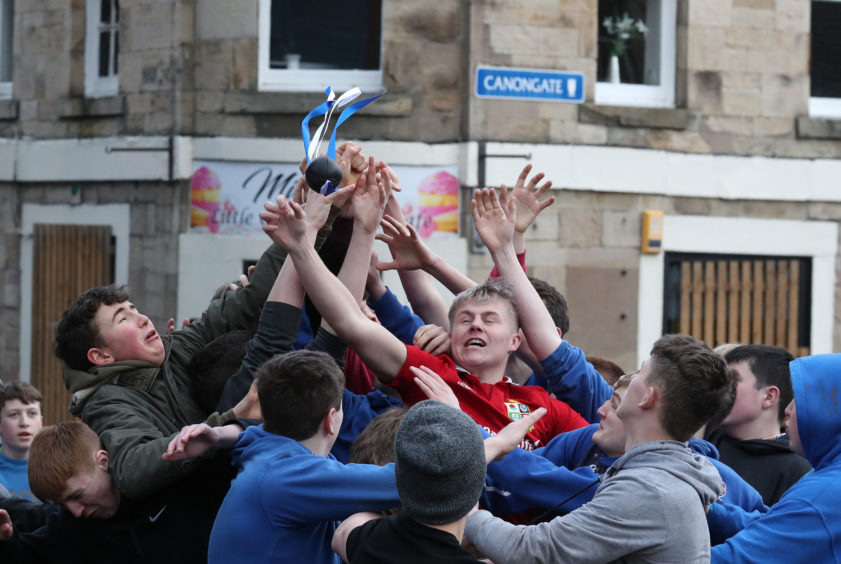 Boys tussle for the leather ball during the annual 'FasternÕs E'en Hand Ba' event on Jedburgh's High Street in the Scottish Borders.