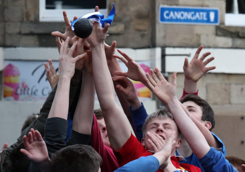 Boys tussle for the leather ball during the annual 'FasternÕs E'en Hand Ba' event on Jedburgh's High Street in the Scottish Borders