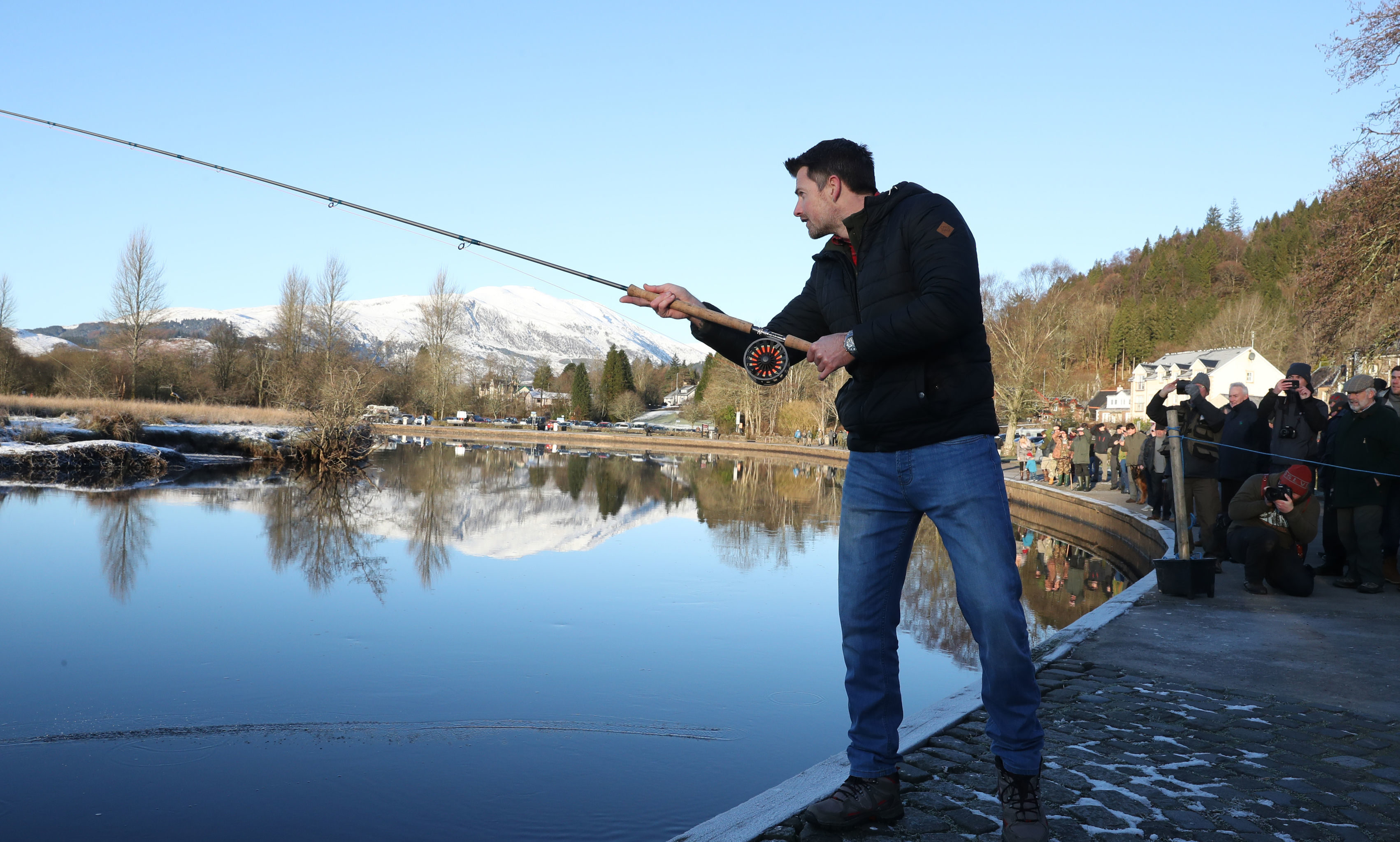 Fisherman James Stokoe, winner of the BBC's Big Fish competition launches  fishery season on the River Teith at Callander,