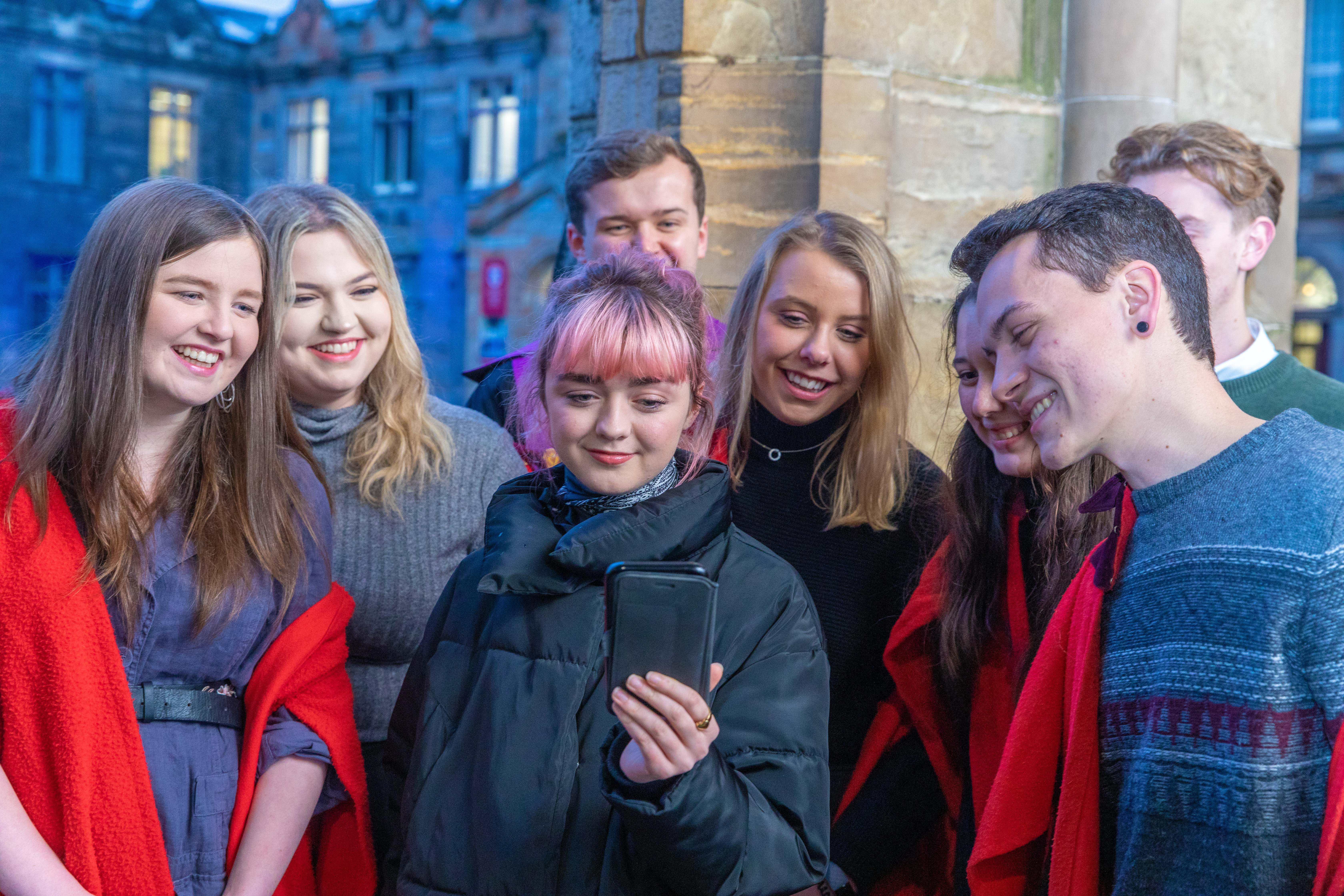 Game of Thrones Actress Maisie Williams with students of St Salvator's Choir.