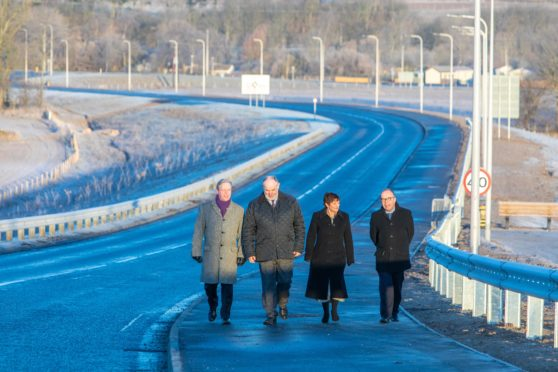 Peter Porteous, Cllr Murray Lyle, the council's Karen Reid and Stephen Scott of Balfour Beatty walk the path of newly opened section of A85.
