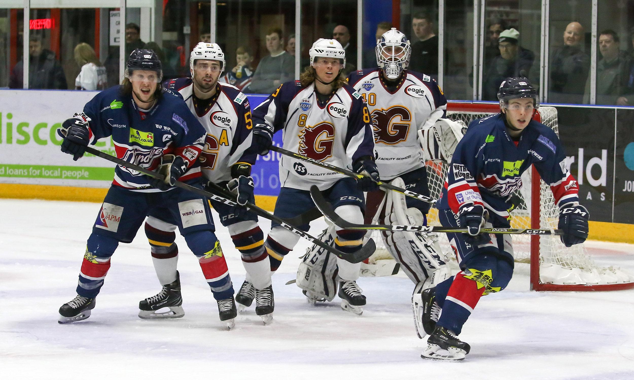 Stars Johan Andersson & Jordan Kelsall attack the Flames goal.