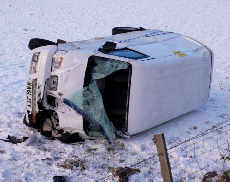 The van rolled over into a field on the A932 near Milldens