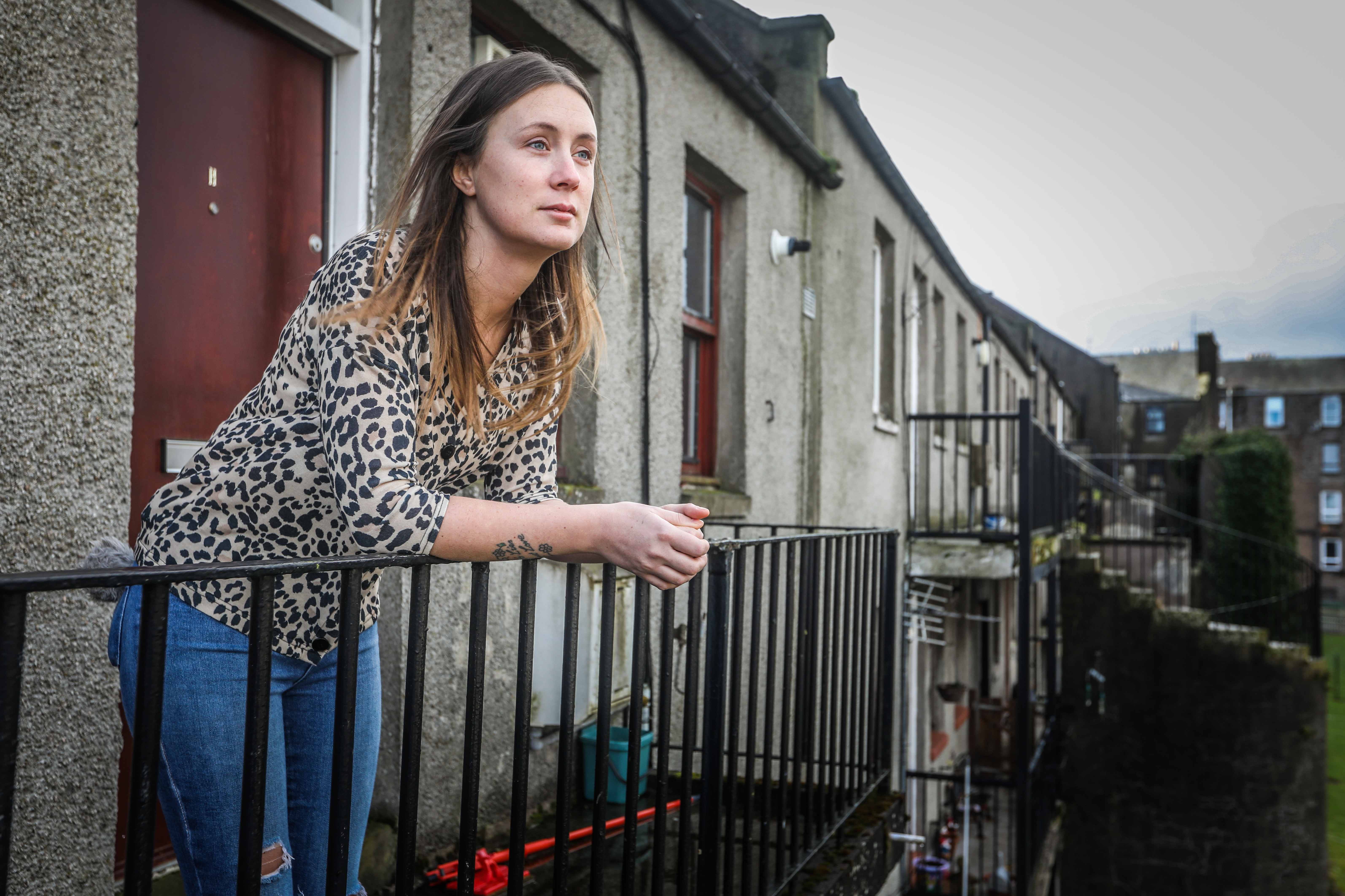 Private tenant Emma Barry outside her flat, which is marked for demolition