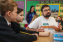 Project Manager Rizwan Rafik speaks to kids at a Dundee primary school.