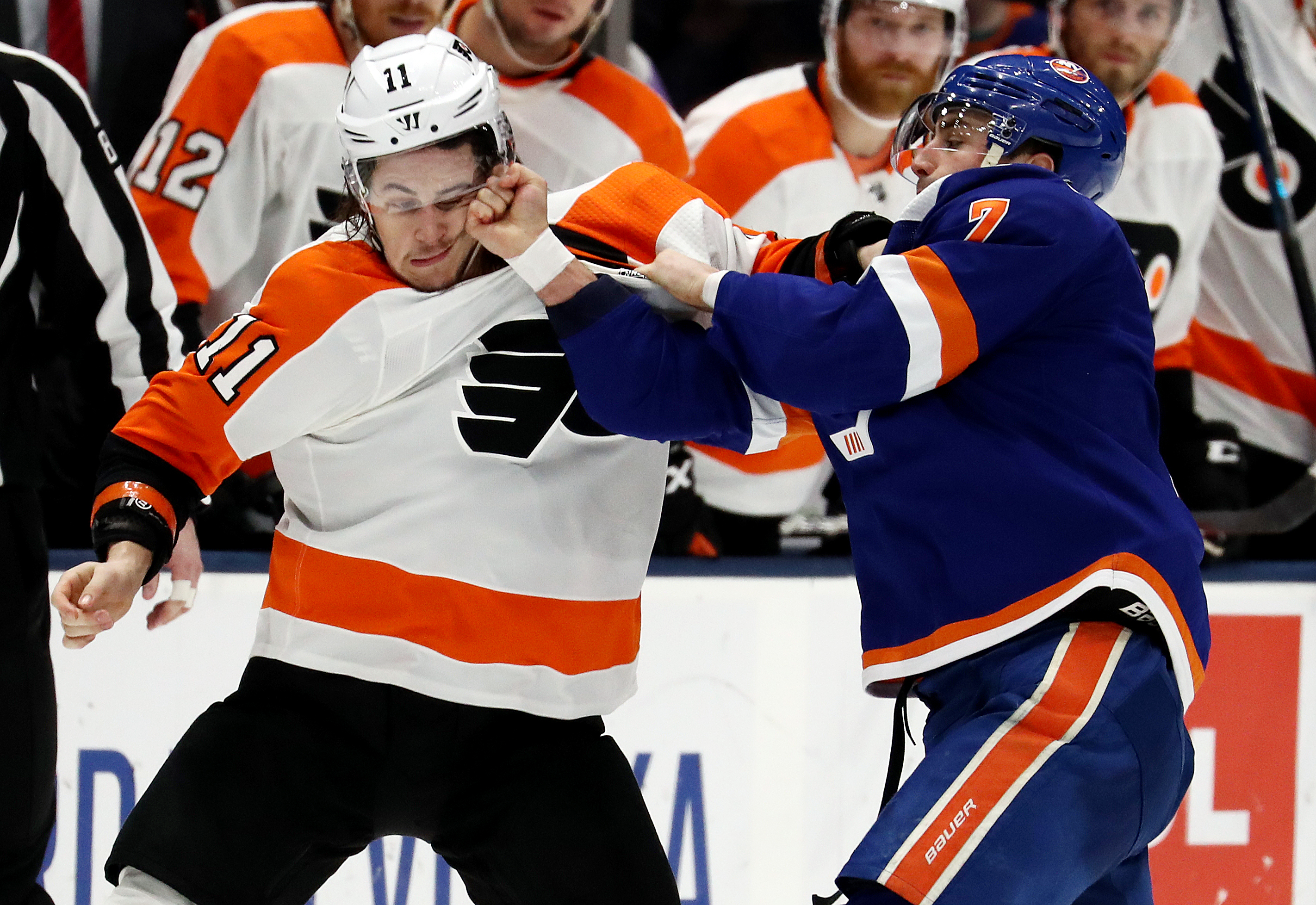Travis Konecny #11 of the Philadelphia Flyers fights with Jordan Eberle #7 of the New York Islanders during their game at NYCB Live's Nassau Coliseum on March 03, 2019 in Uniondale, New York.