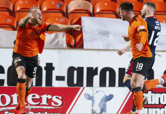 United pair Mark Connolly and scorer Calum Butcher celebrate after the winner against County last month.