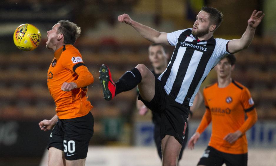 Dunfermline's Daniel Devine (R) challenges Dundee United's Peter Pawlett.