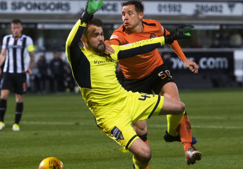 Dundee United's Peter Pawlett (R) in action with Dunfermline's Ryan Scully.