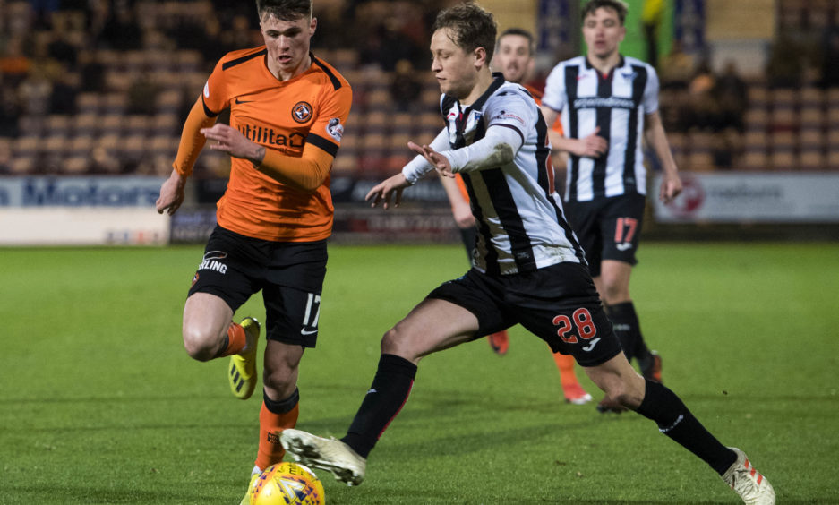 Dundee United's Jamie Robson (L) in action with Dunfermline's James Craigen.