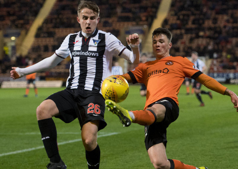 Dunfermline's James Craigen (L) in action with Dundee United's Jamie Robson.