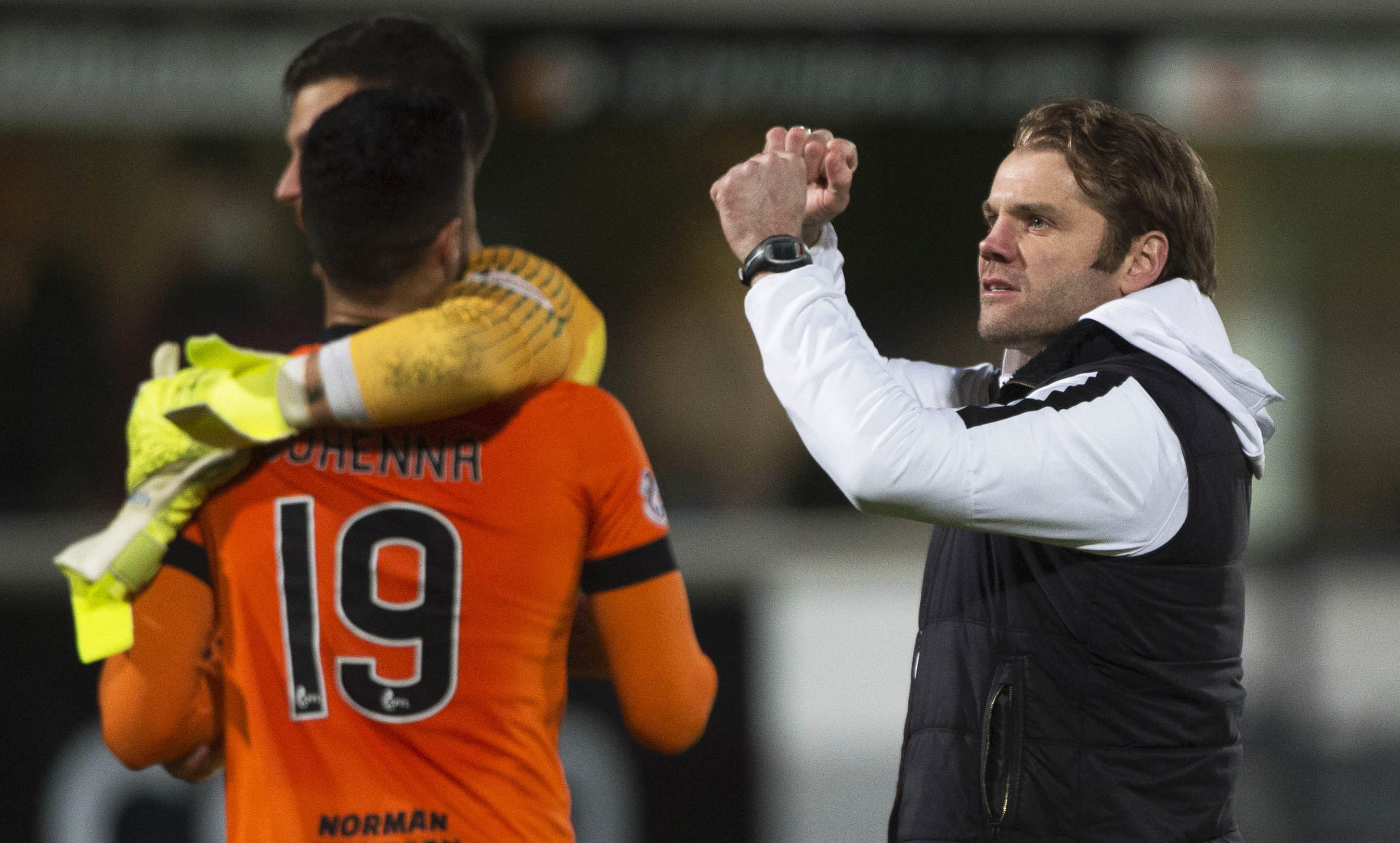 Robbie Neilson, right, celebrates at the final whistle.