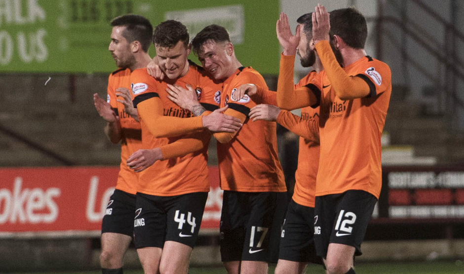 Dundee United celebrate in front of the fans at full-time
