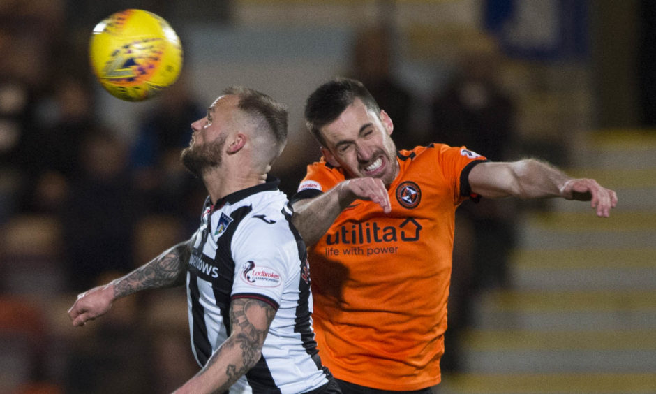 Dunfermline's Kallum Higginbotham (L) in action with Dundee United's Callum Booth