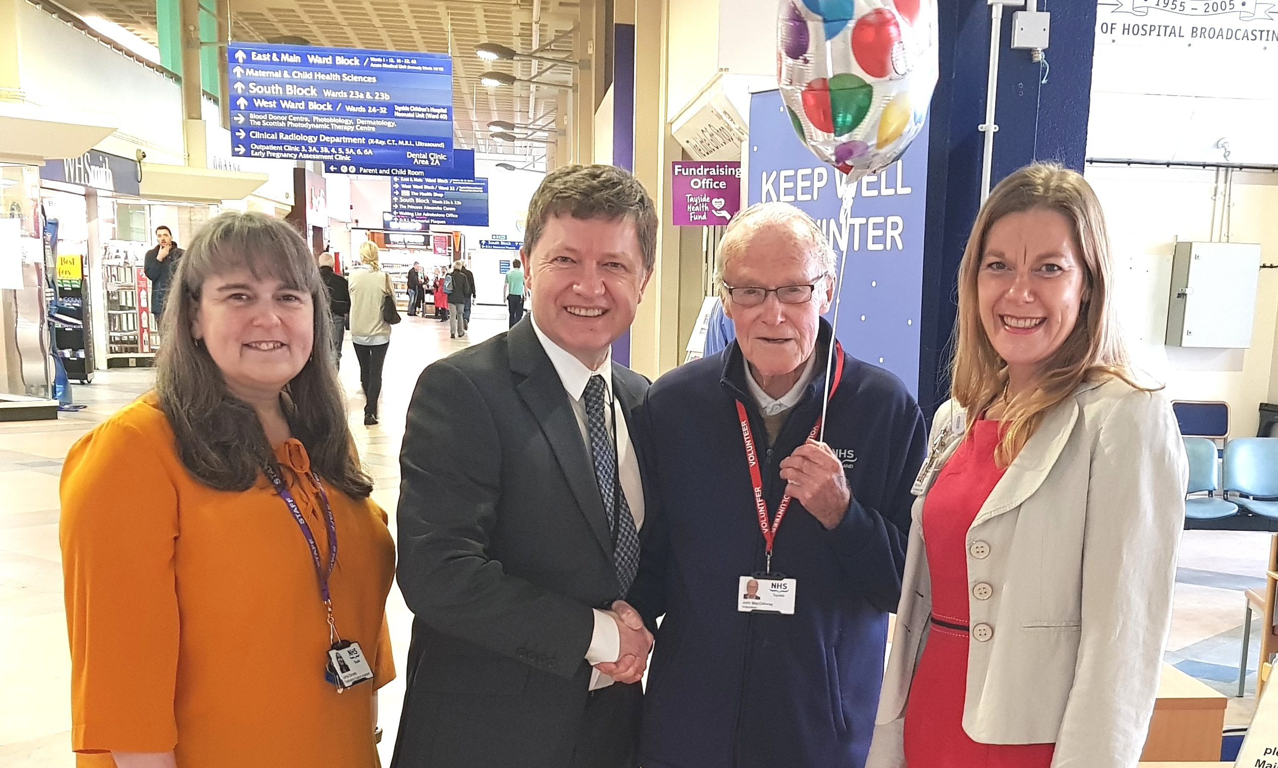John MacGillivray is congratulated by fundraising support officer Lorna Donnelly, chief executive Grant Archibald and clinical governance and risk management team leader Tracey Passway.