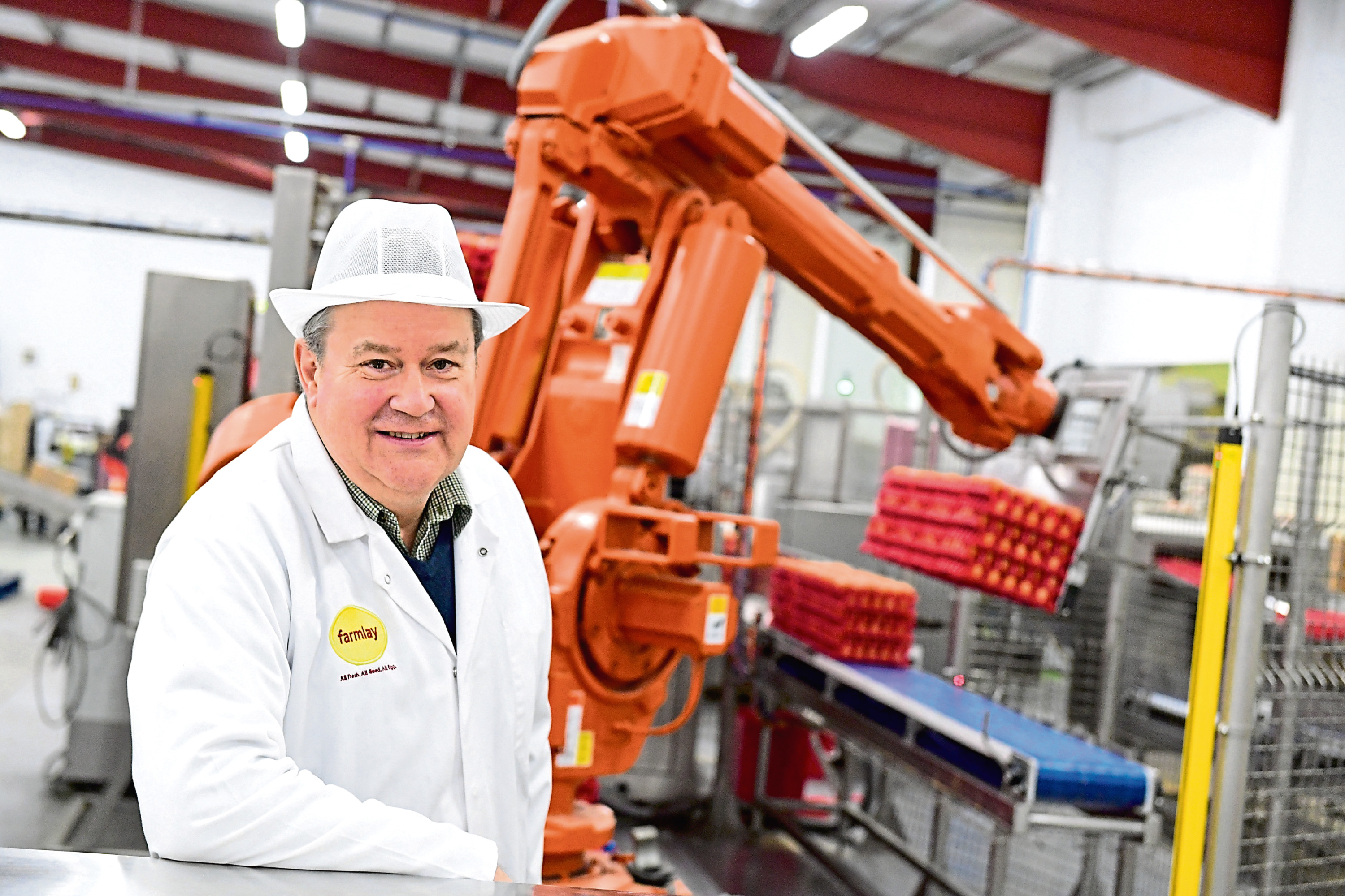 Robert Chapman of Farmlay Eggs with the robots at the firm's plant in Strichen.