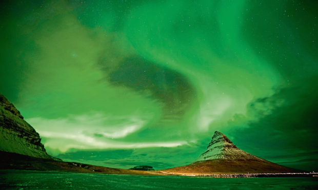 Aurora Borealis, the Northern Lights, over Kirkjufell, a 463 metre mountain on the west coast of Iceland.