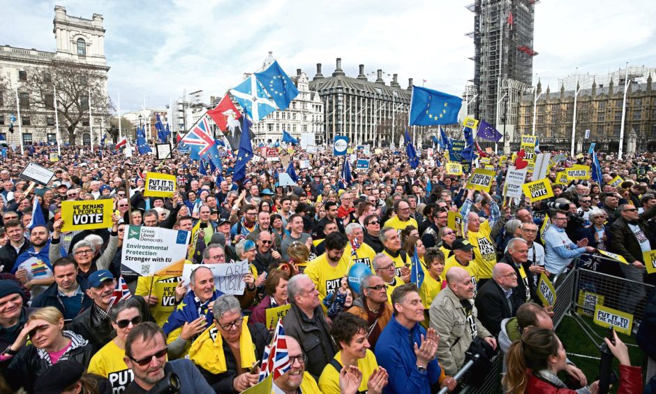 Anti-Brexit campaigners gather in Parliament Square, as they take part in the People's Vote March in London.