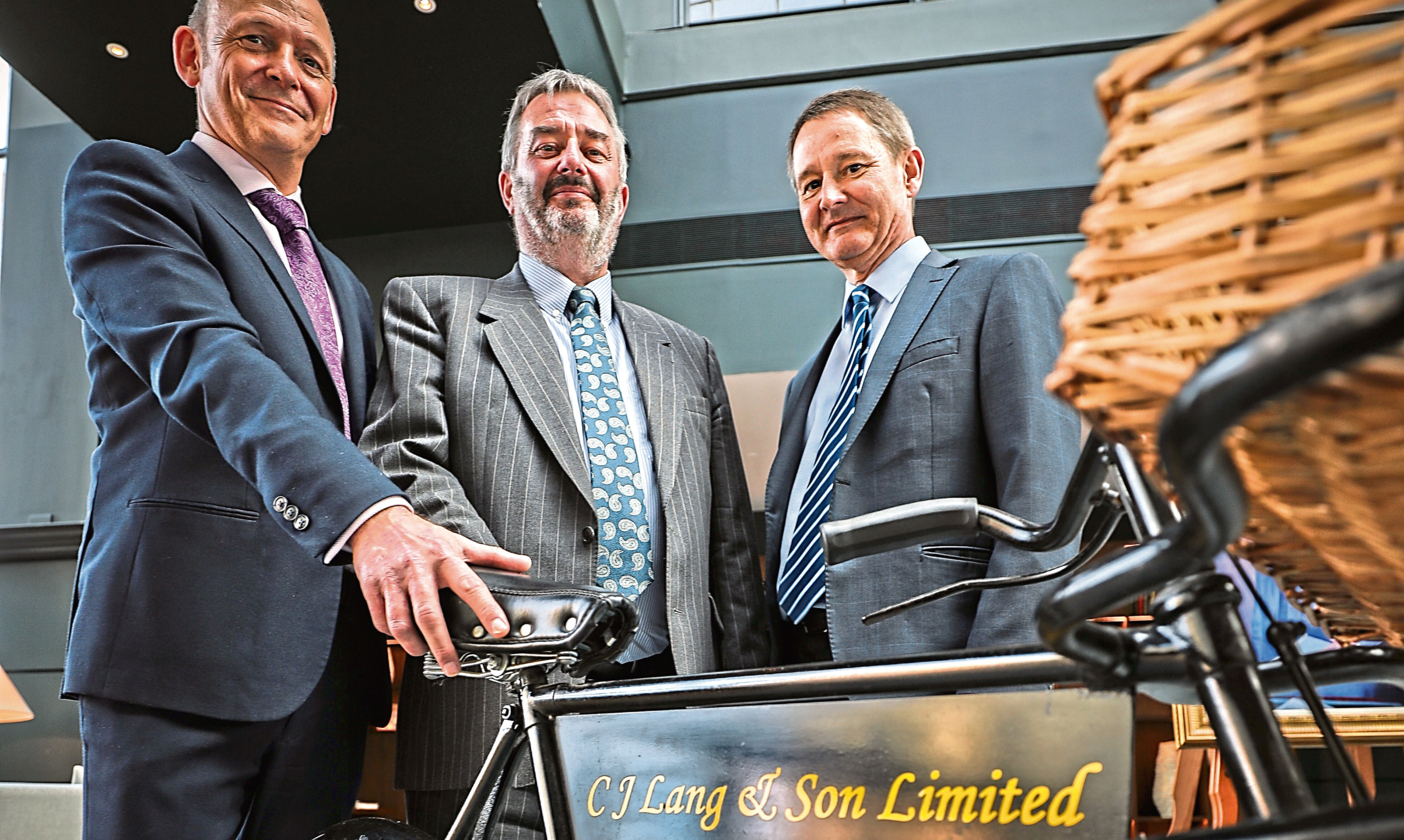CJ Lang & Sons merchandising director Jamie Buchanan, trading director David Lamb and IT director Graham Murdoch at yesterdays celebration event at the Fairmont Hotel in St Andrews.