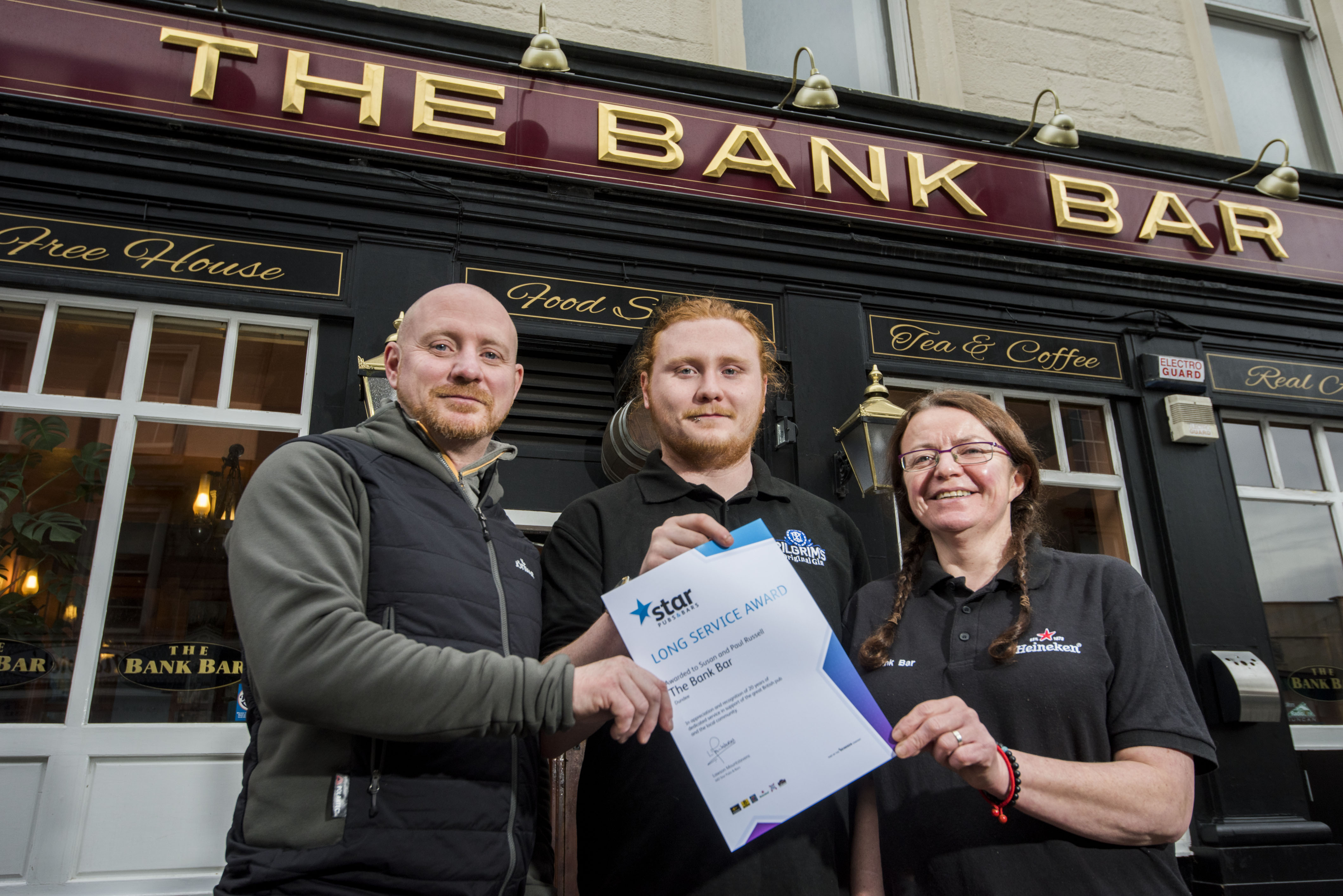 Licensees Paul and Susan Russell with Paul's son Ciaran Russell - who is the bar manager - in the centre.