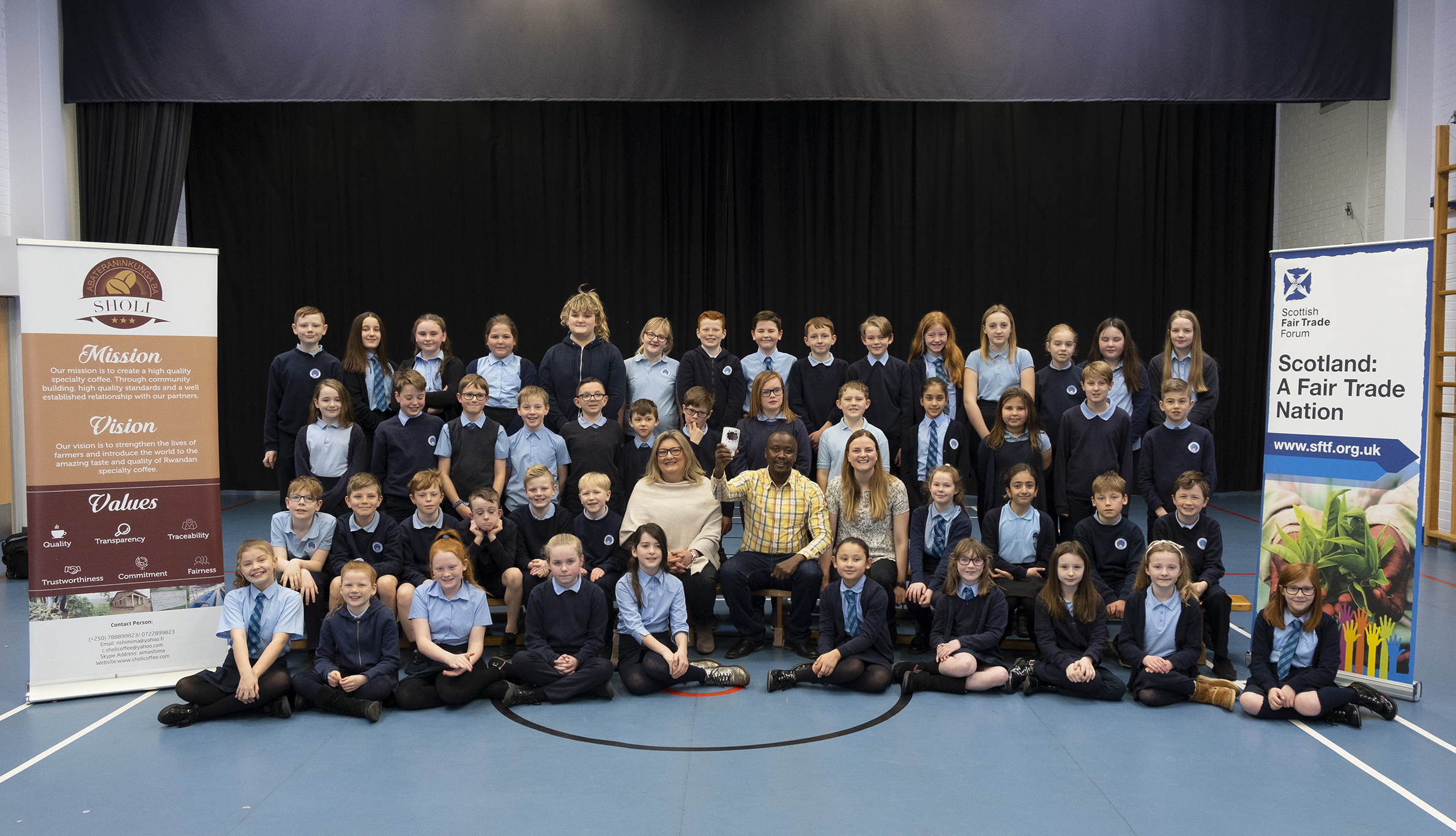 Carlogie pupils with Development Officer Carrie Sweeney, coffee farmer Aimable Nshimiye and  Colleen Tait of the Scottish Trade Forum.