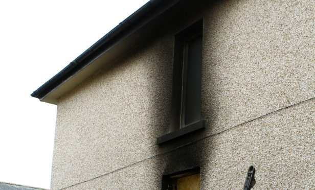 The fire damaged house in Timmons Park in Lochgelly.