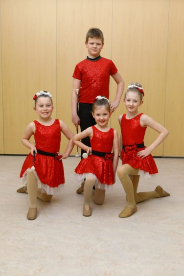 The winners of the Twirling Group - Tots ages 6 to 8, FRONT L/R, Sarah Green, Ella Hamilton, Kourtney Whytock, and Taylor Whytock at the back, all from the Fair City Baton Twirlers.