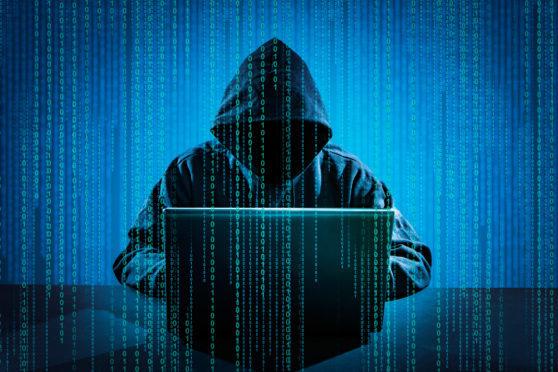 Hacker using laptop.