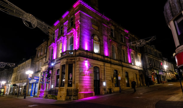 Dunfermline buildings were lit up to celebrate the continuation of its Purple Flag scheme
