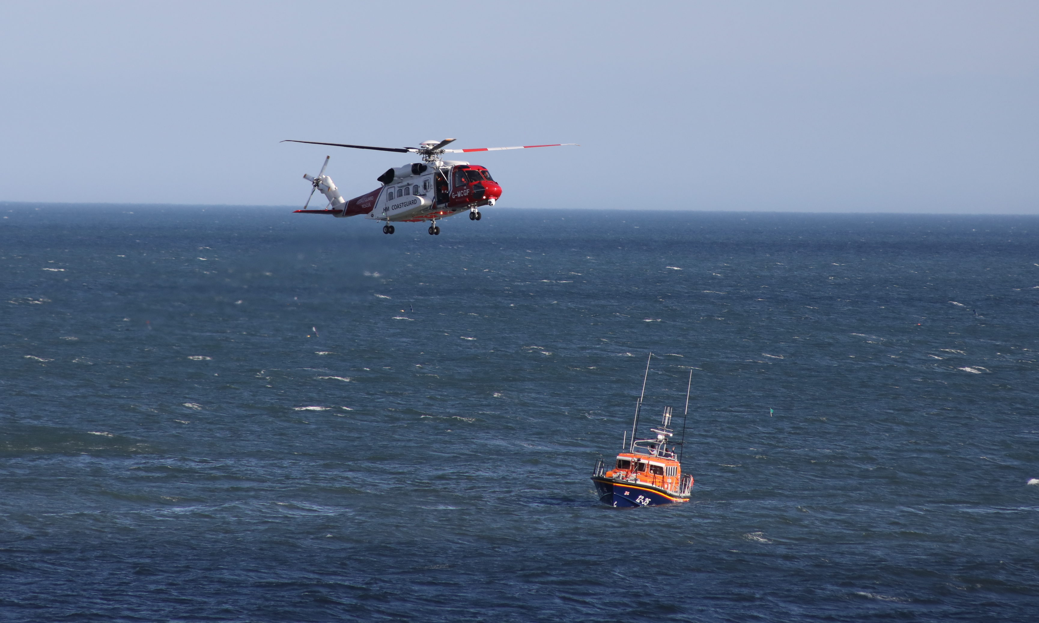 The UK Coastguard helicopter at Arbroath Cliffs.