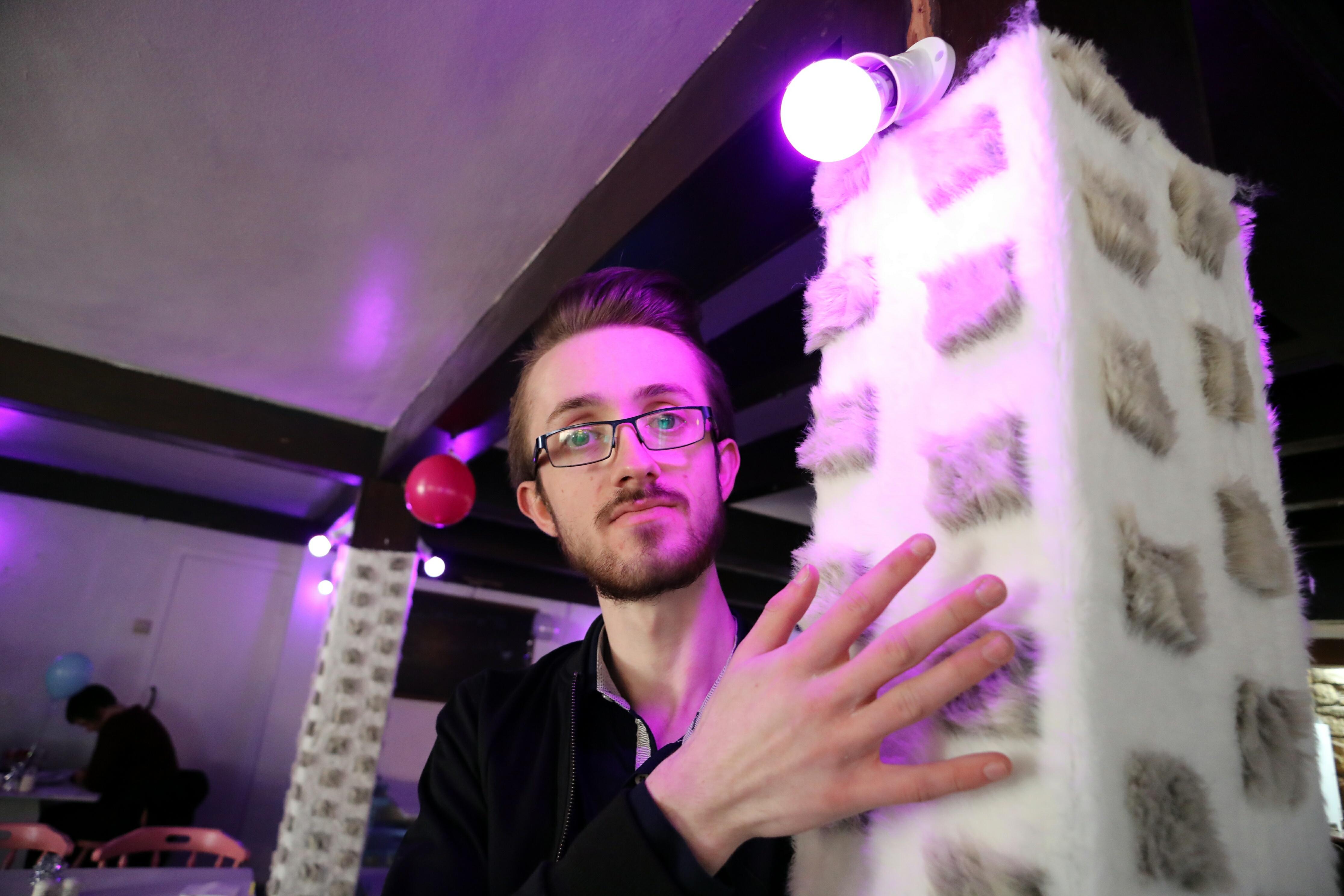 Trainee deputy manager Bradley Ramsay shows tactile pillars in autism-friendly Sensoriale