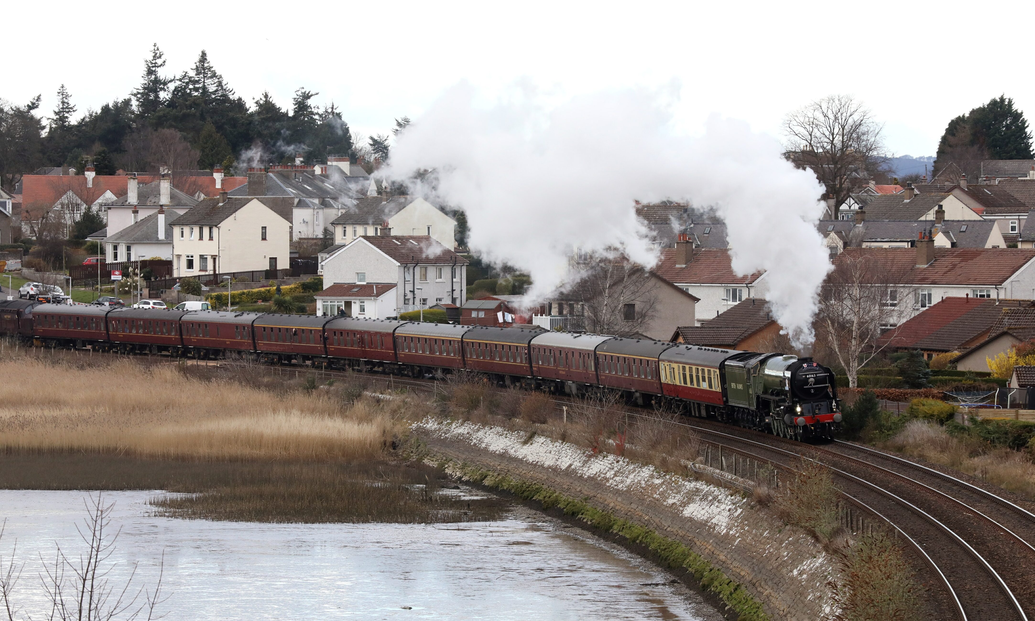 The Tornado steam train passing through Invergowrie Bay.