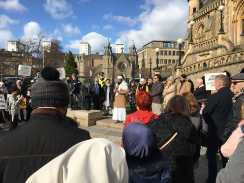 Imam Hamza from Central Mosque addresses Saturday's rally.