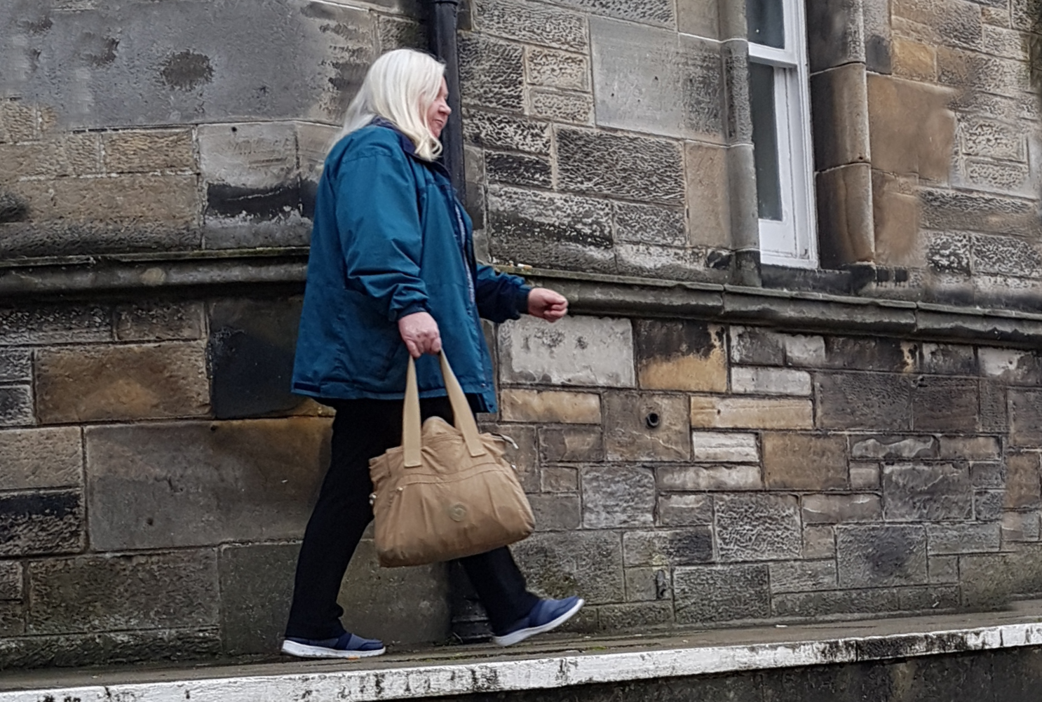 Joyce Hollywood arriving at Kirkcaldy Sheriff Court.