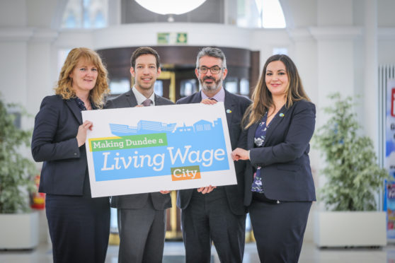 Cllr John Alexander, leader of Dundee City Council, Christine McGlasson, managing director of  Xplore Dundee, Ellis Watson, DCT Media, Lyn Anderson, Living Wage Scotland and Peter Kelly, director of the Poverty Alliance. ,