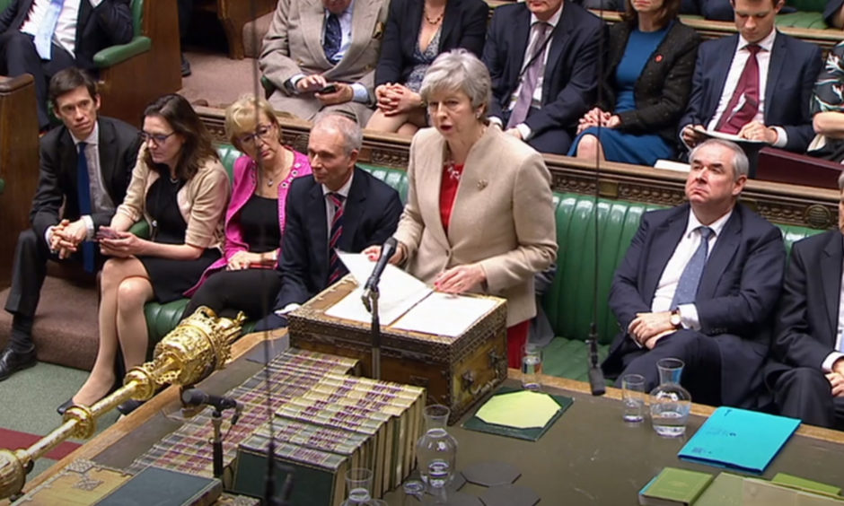 Prime Minister Theresa May speaks in the House of Commons during a Brexit debate.