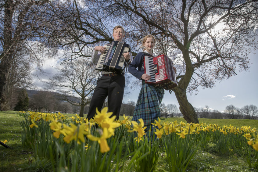 Hamish Landale and Kirsty Kilpatrick (both Glenalmond College) following their performances in the Accordion Solo (Elementary) Scottish Traditional Music.