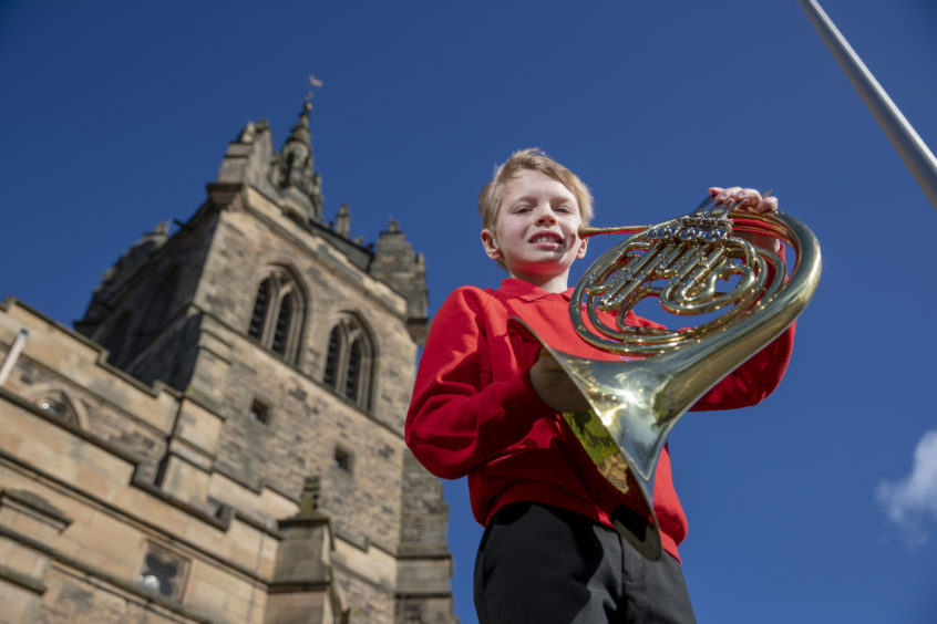 Alasdair Bell (Muthill Primary School) is all smiles after winning Horn in F Solo.