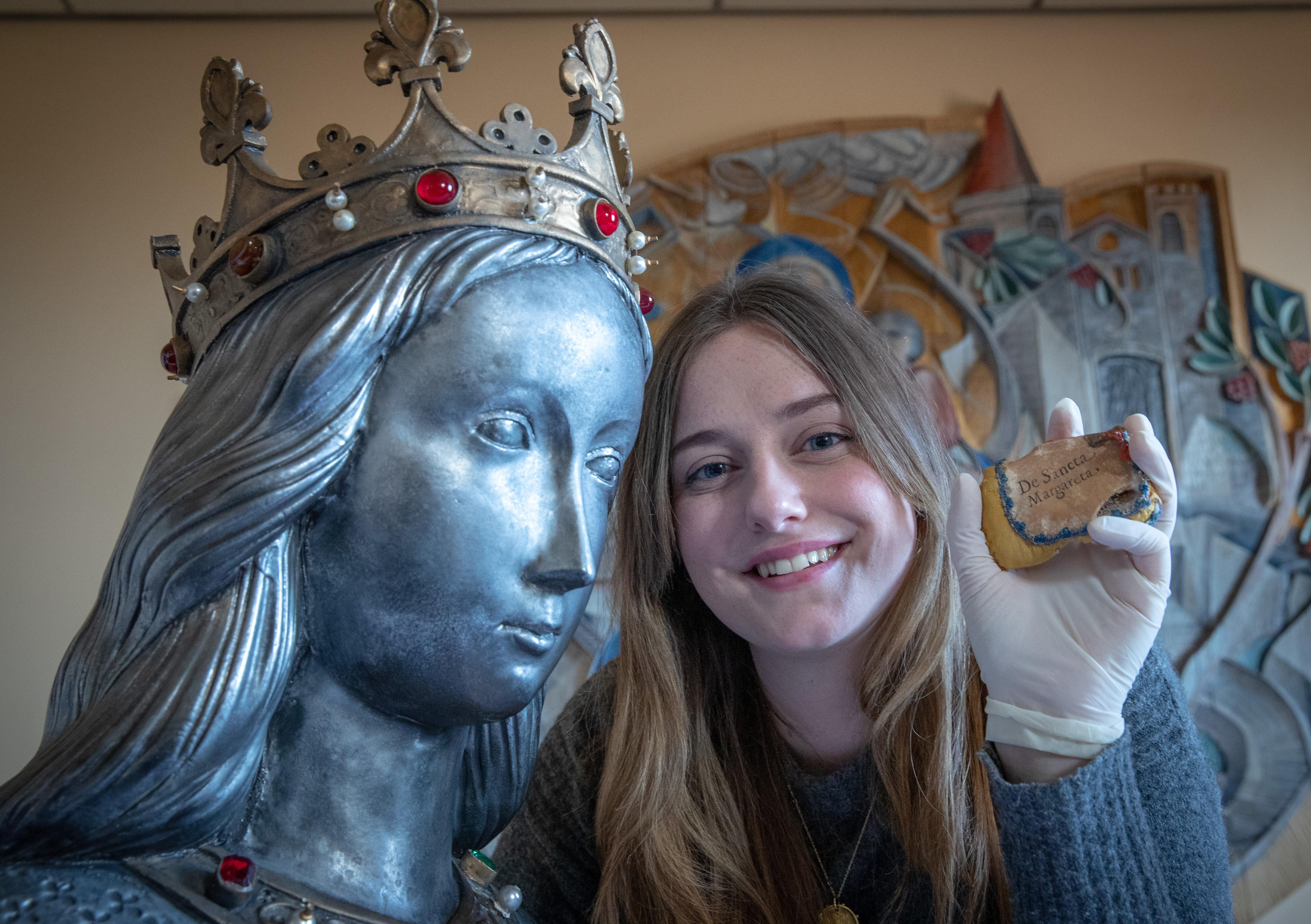 Lauren Gill with the relic of St Margaret