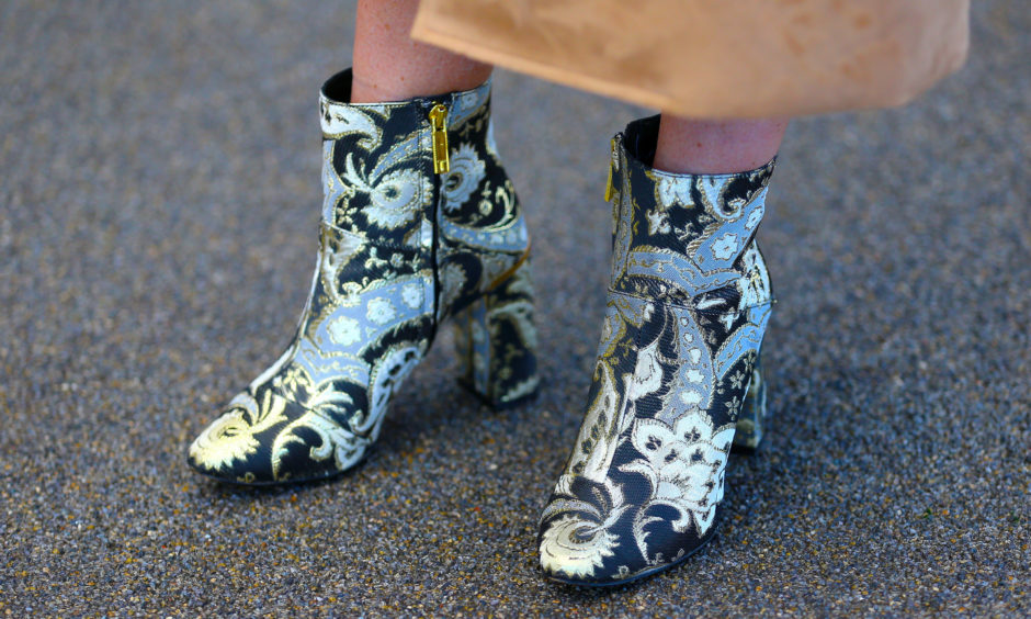 Detail of a racegoers Ted Baker boots.