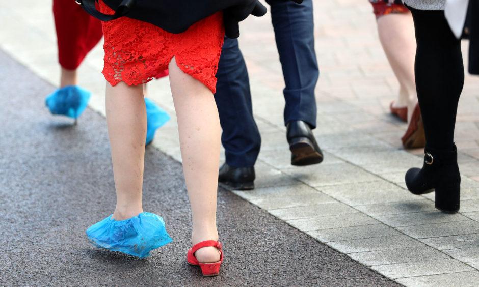 A racegoer wearing a plastic shoe cover during St Patrick's Thursday.